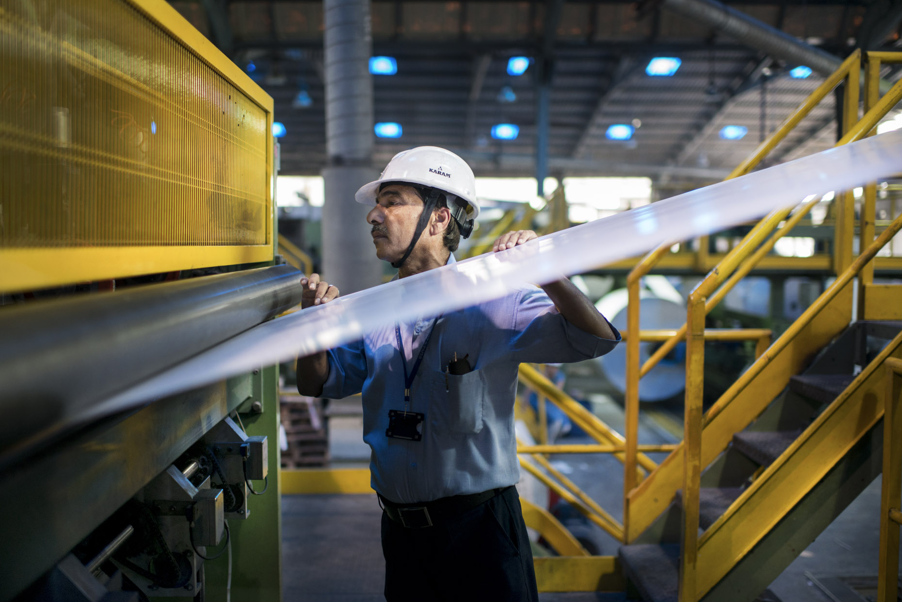 Worker Inspecting Paper |Century Pulp & Paper Factory | Birla Group | India | Stefen Chow